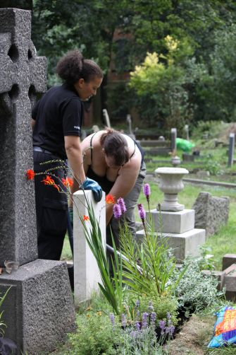 Community police assisting in graveyard clear-up